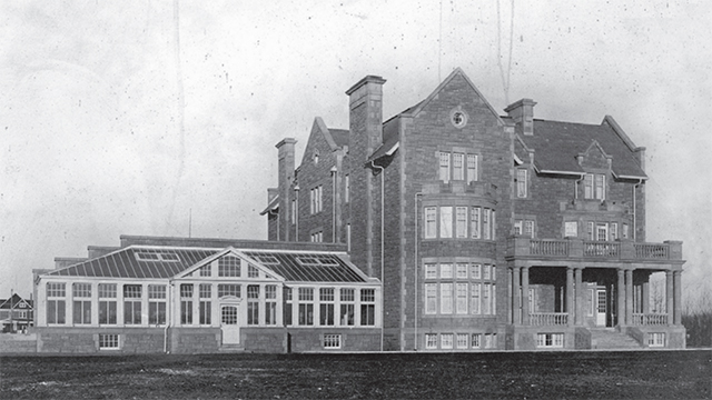 An archived photo of Government House with the conservatory attached.
